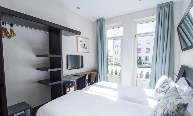 Foto de la habitación de un hotel que admite perros gratis en la ciudad de Valencia, un lugar ideal para visitar esta ciudad con tu mascota